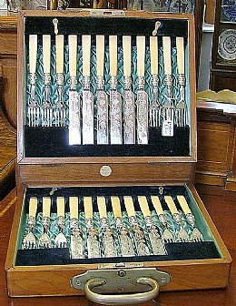 set of 12 dessert fruit knives/forks with silver mounts